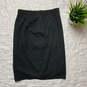 The limited black high waisted pencil skirt